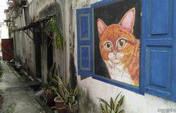 Lukisan mural kucing meow di kawasan Penang Street Art
